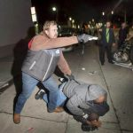 Picture about Undercover Cop Draws Gun on Protesters in Oakland after Outing