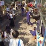 Screenshot of Girl with Superpowers Thrashing Boys at Thailand Bus Stop