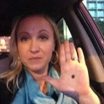 Picture Suggesting If You Ever Notice a Black Dot on Someone's Palm, Call the Police