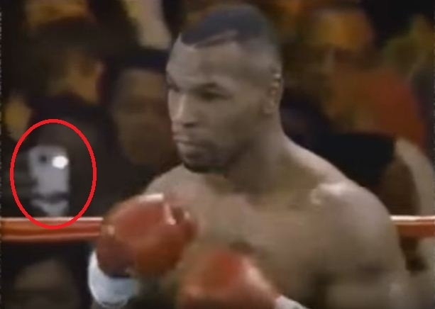 Picture about Unexplained Time Traveler Captured at Mike Tyson Fight