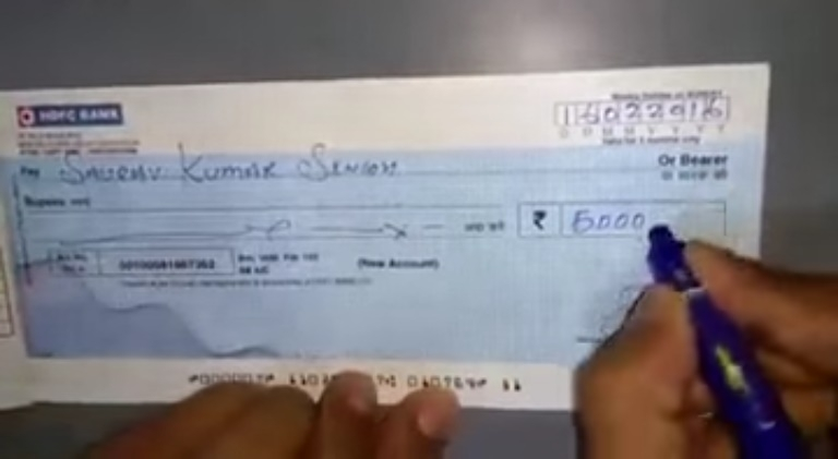 Picture Suggesting Beware of Cheque Fraud - Erasing and Re-writing